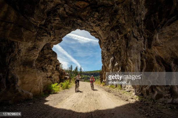 family biking at the myra canyon trestles near kelowna - okanagan valley stock pictures, royalty-free photos & images