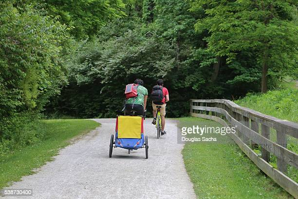 family biking on the recreational trail, cuyahoga valley national park, ohio, usa - cuyahoga river stock photos and pictures