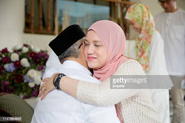 family blessing during raya celebration - forgiveness stock pictures, royalty-free photos & images