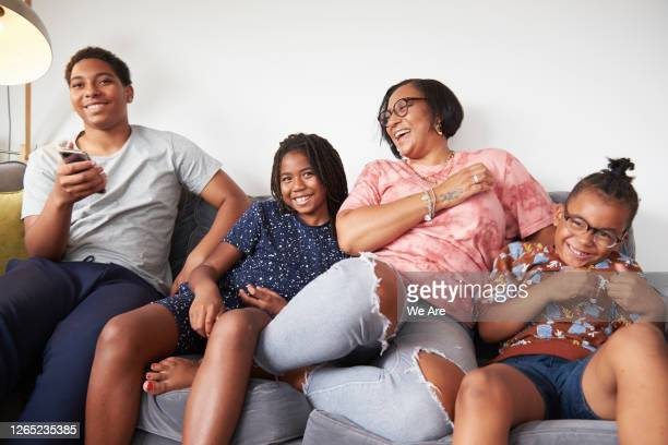 family bonding at home on sofa - fashionable stock pictures, royalty-free photos & images