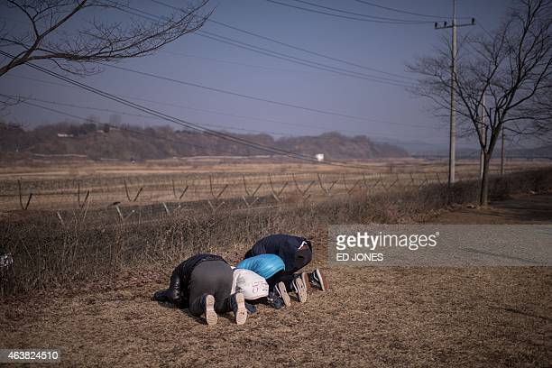 A family bow in the direction of North Korea at Imjingak park south of the Military Demarcation Line and Demilitarized Zone separating North and...