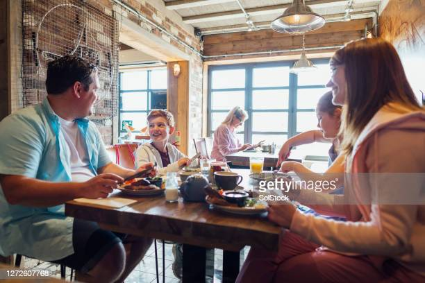family breakfast - restaurant stock pictures, royalty-free photos & images
