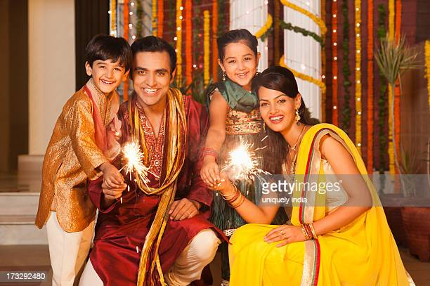 Family burning fire crackers on Diwali
