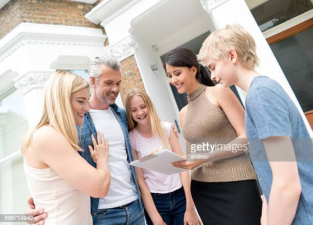 Family buying a house from a real estate agent