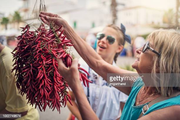 Family buying dried chili peppers at the farmer's market