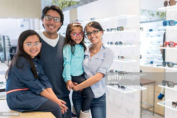 Family buying glasses at the optician