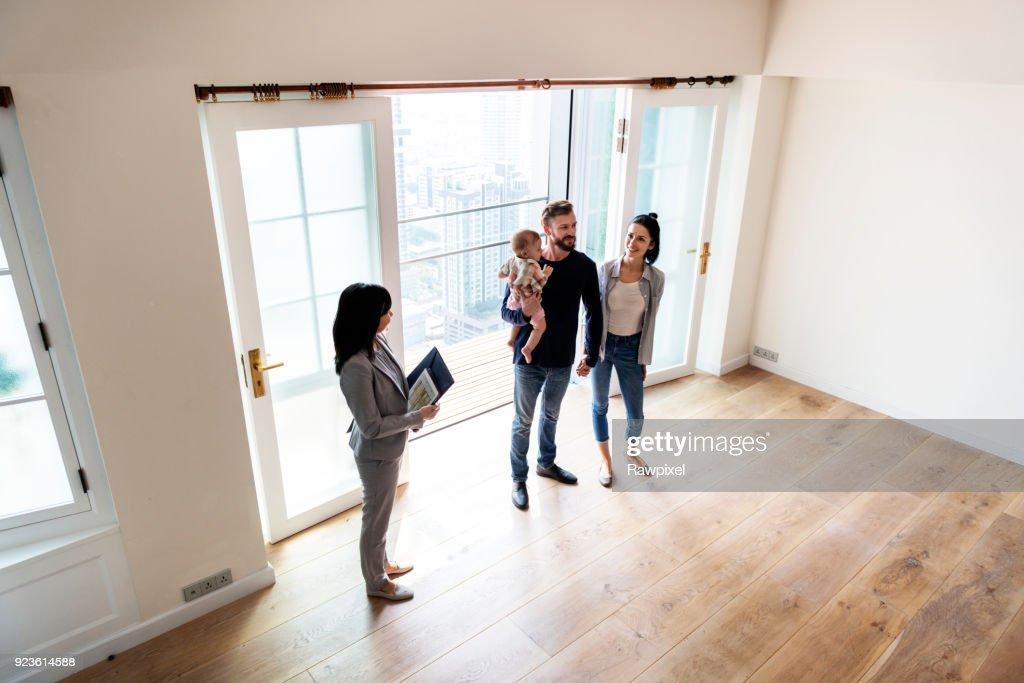 Family buying new house : Stock Photo
