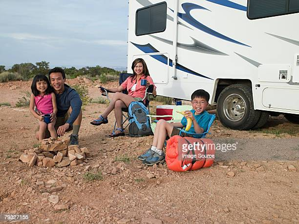 Family by motor home