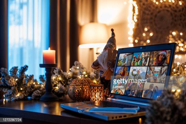 family calling on a home office set up for webinar and teleconference at christmas lockdown - feriado imagens e fotografias de stock