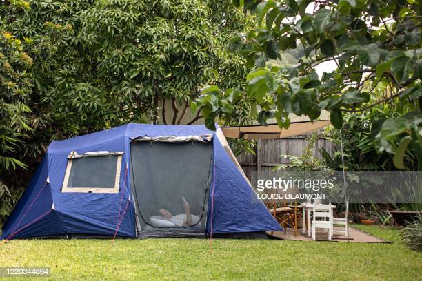 family camping in the backyard - tent stock pictures, royalty-free photos & images