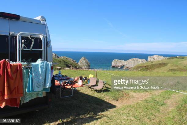 Family camping near Berellin beach. Cantabria region, Spain.