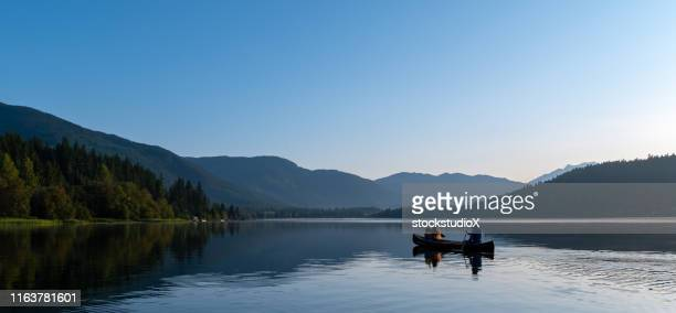 family canoeing on a mountain vacation - british columbia stock pictures, royalty-free photos & images
