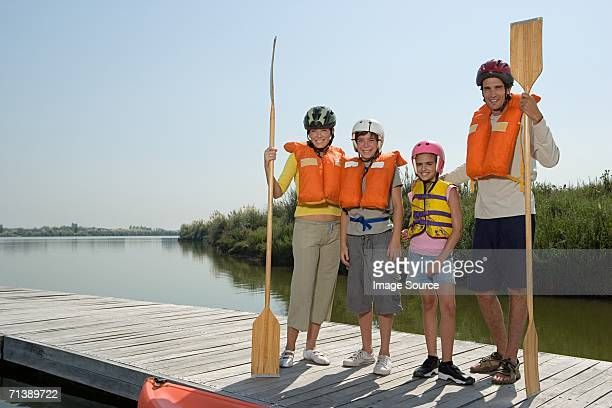 family canoeing - life jacket stock pictures, royalty-free photos & images