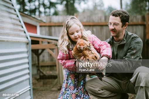 Family Caring For Their Chickens