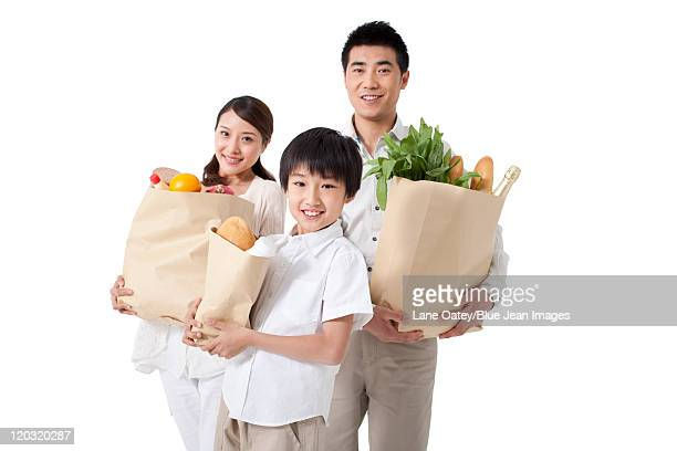 Family Carrying Bags of Groceries
