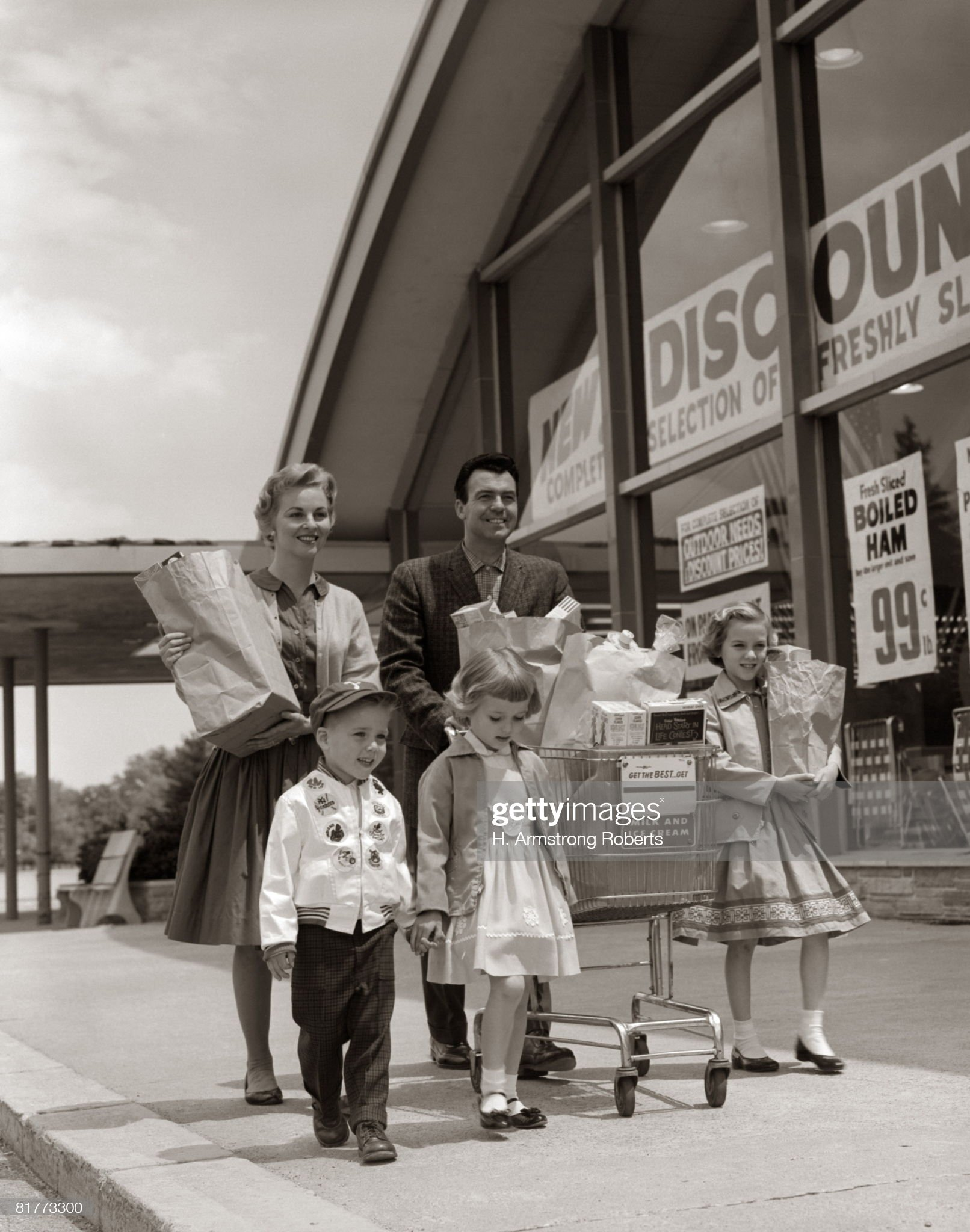 Family Carrying Groceries Home. : Photo