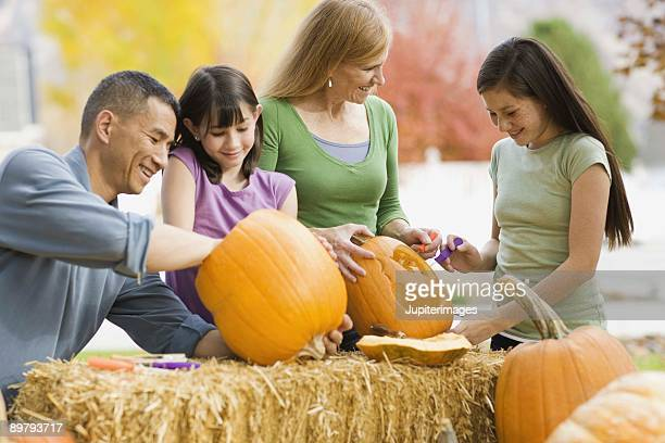 Family carving pumpkins