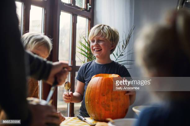 Family carving pumpkins together for halloween
