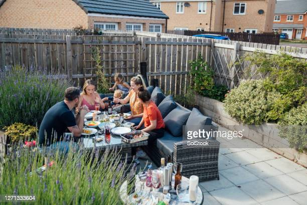 family catching up together - outdoors stock pictures, royalty-free photos & images