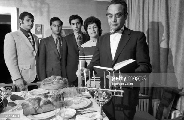 Family celebrate Hanukkah in their home, Brookline, Massachusetts, 1971.