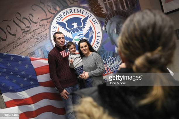 A family celebrates American citizenship following a naturalization ceremony on February 2 2018 in New York City US Citizenship and Immigration...