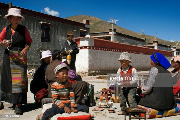 Family celebrates the graduation of a relative in the village of Bainans, located along the road separating Shigatse from Gyantse, Tibet, China.