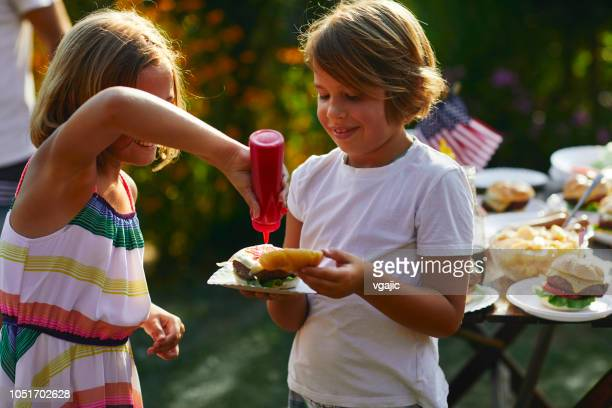 family celebrating 4th of july - ketchup stock photos and pictures