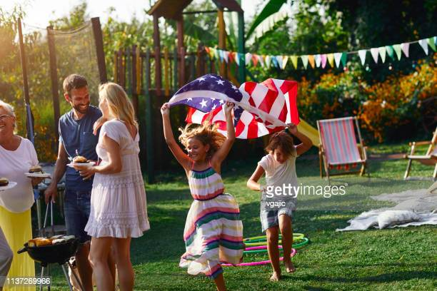 family celebrating 4th of july - patriotic stock pictures, royalty-free photos & images