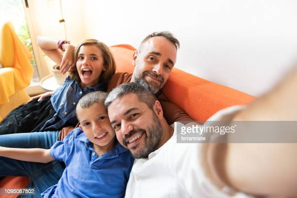 family celebrating a birthday - gay couple stock pictures, royalty-free photos & images