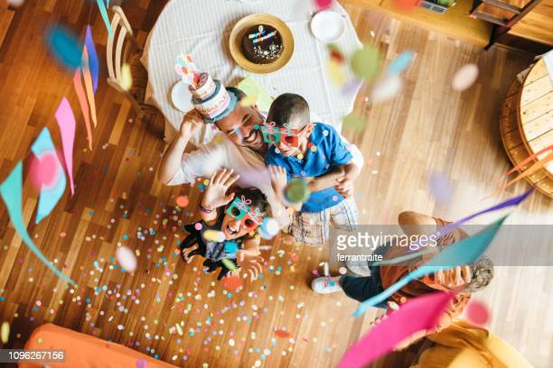 family celebrating a birthday - happy birthday stock pictures, royalty-free photos & images