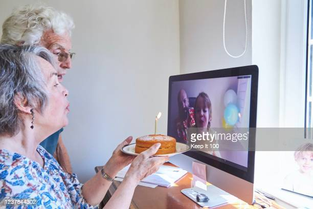 family celebrating a birthday together via video call - emotion stock pictures, royalty-free photos & images