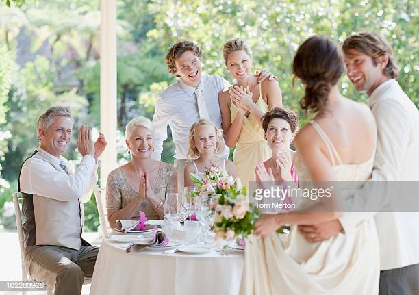 family celebrating at wedding reception - guest stock pictures, royalty-free photos & images