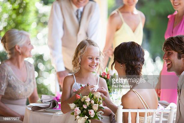 family celebrating at wedding reception - wedding guest stock pictures, royalty-free photos & images
