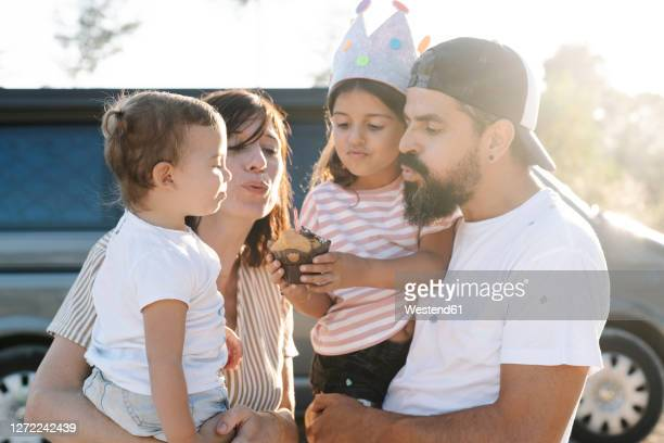 family celebrating birthday against van at park during sunset - happy birthday images for sister stock pictures, royalty-free photos & images