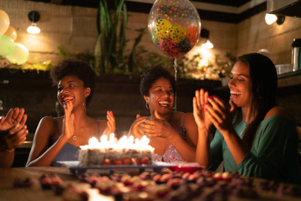 family celebrating birthday party at home - best friend birthday cake stock pictures, royalty-free photos & images