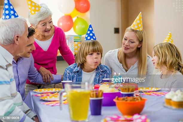family celebrating boy's birthday - paper plate stock photos and pictures