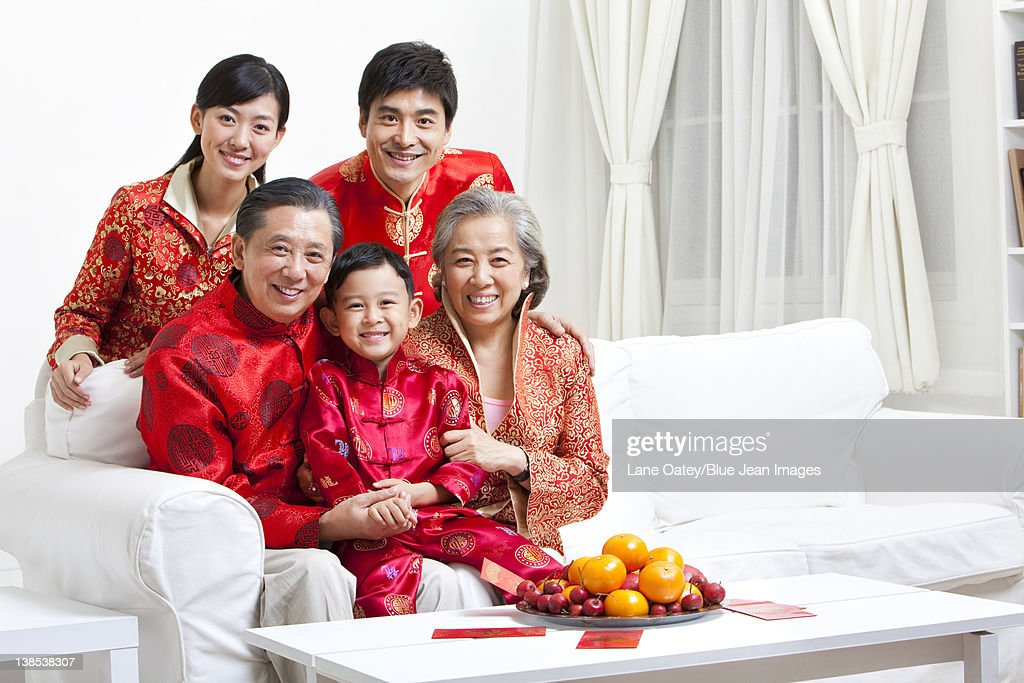 Family Dressed in Traditional Clothing Celebrating Chinese ...