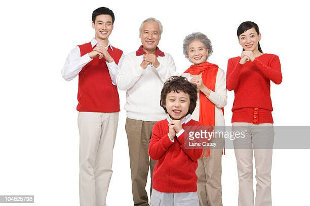 family celebrating chinese new years - 25 29 years photos stock photos and pictures
