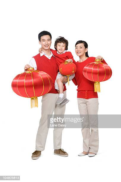 family celebrating chinese new years - 30 39 years imagens e fotografias de stock