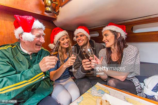 Family Celebrating Christmas Below Deck on a Yacht