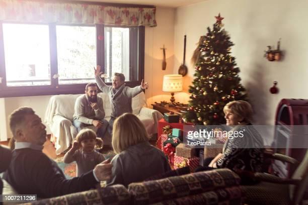 Family celebrating Christmas Holidays at home