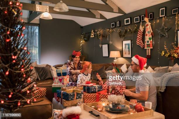 family celebrating christmas - christmas stock pictures, royalty-free photos & images
