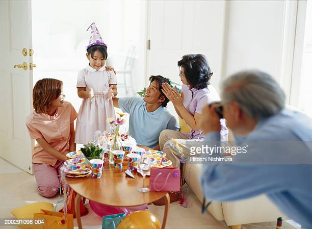 family celebrating daughter's (4-7) birthday - asian granny pics stock photos and pictures