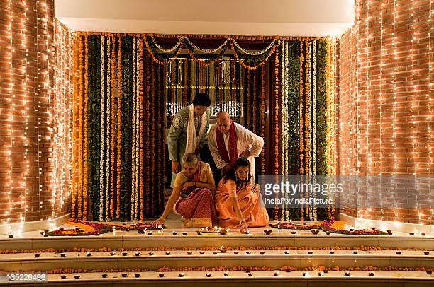 family celebrating diwali - diwali stock pictures, royalty-free photos & images