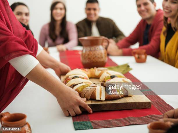 family celebrating epiphany together - roscon de reyes stock pictures, royalty-free photos & images