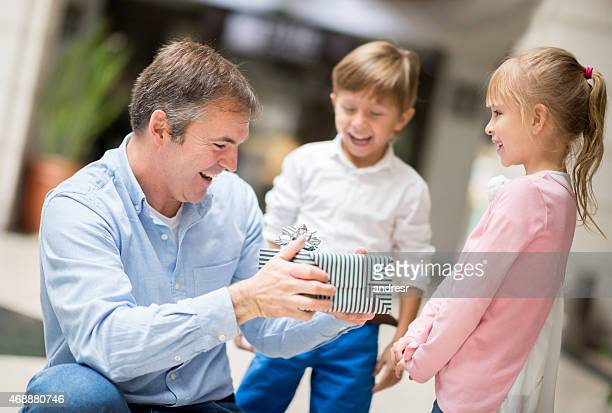 family celebrating father's day - fathers day stock pictures, royalty-free photos & images