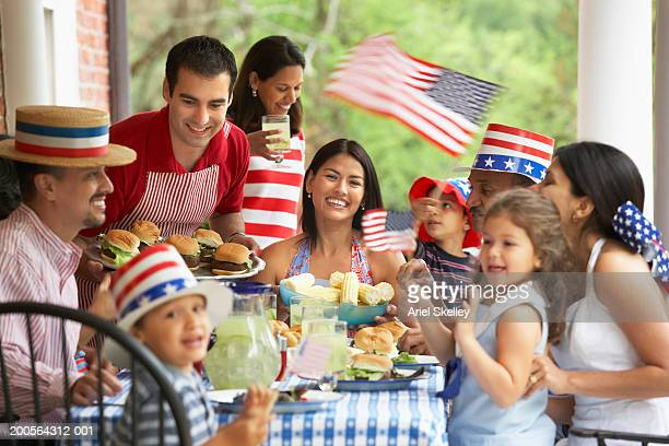 family celebrating fourth of july - happy independence day foto e immagini stock