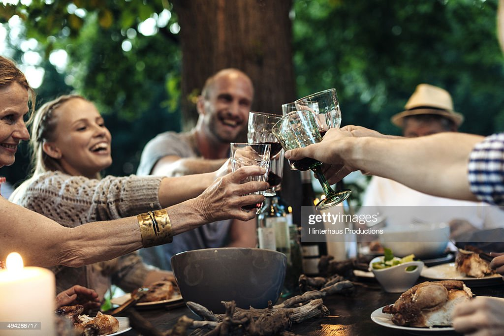 Family Celebrating Garden Party : Stockfoto