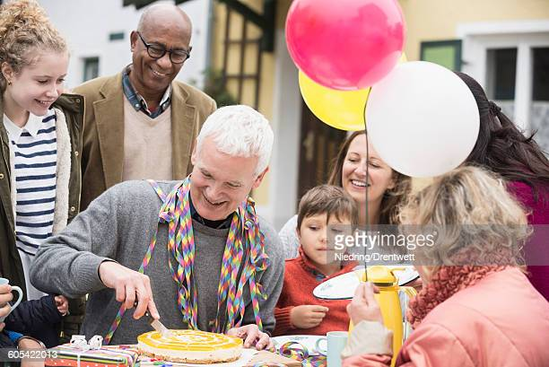 Family celebrating grandfathers birthday, Bavaria, Germany