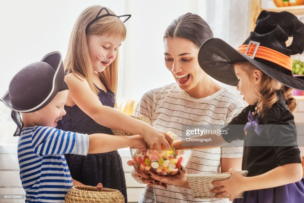 family celebrating Halloween : Stock Photo
